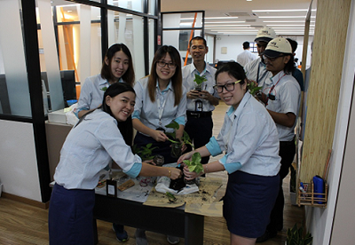 Group photo from TMS Prai Office while planting plants